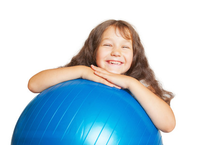 exhilarated: Happy little girl with big fitness ball. Isolated on white background.