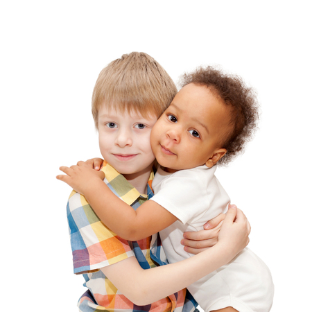caucasian children: Multiracial happy family. White brother hugging black baby sister.