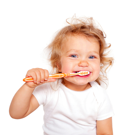 oral care: Cute baby toddler brushing teeth. Isolated on white background.