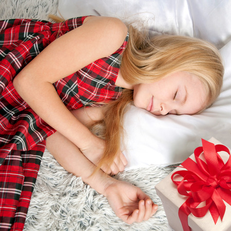 god box: Adorable little girl sleeping. Somebody put a gift by her side. Dreams come true!