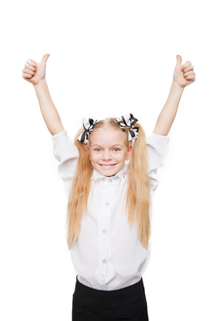 Happy school girl showing thumbs up symbol. Isolated on white background Stock Photo