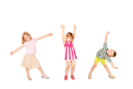 Funny little kids dancing. Isolated on white background Stock Photo