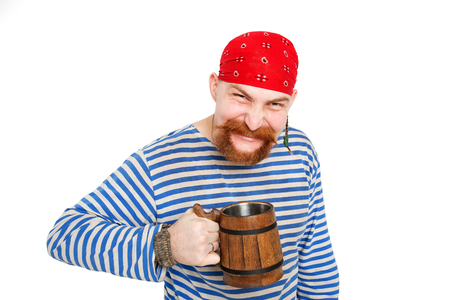 yahoo: Happy Pirate drinking beer from a big wooden mug. Isolated on white background.