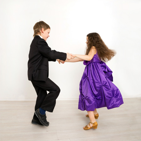 gym dress: Little kids dancing together on the kids party. First love.