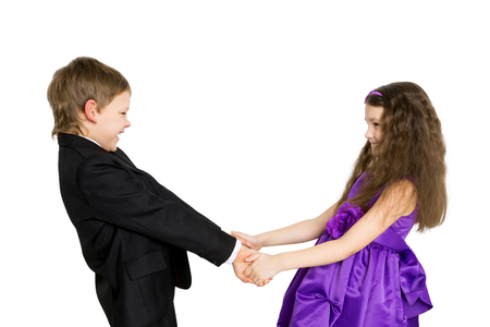 emotional freedom: Young children holding hands and smiling. Side view. Isolated on white background