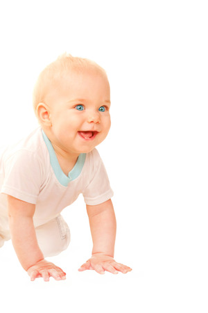 baby crawling: Smiling baby crawling and looking out. Isolated on white background. Stock Photo