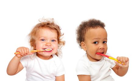 Black and white baby toddlers brushing teeth. Isolated on white background. Stockfoto