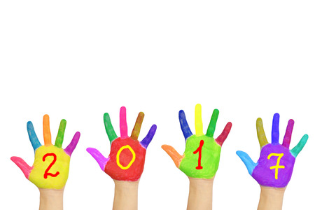 seven years: Kids colorful hands forming number 2017. Isolated on white background. The symbol of the new year Stock Photo