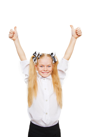 schoolgirl uniform: School child is happy and give thumbs up. Back to school! School concept isolated on white
