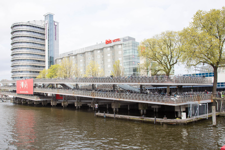 parking station: AMSTERDAM, NETHERLANDS - APRIL 22, 2016: Huge bike bicycle parking station near Amsterdam Centraal railway station Editorial