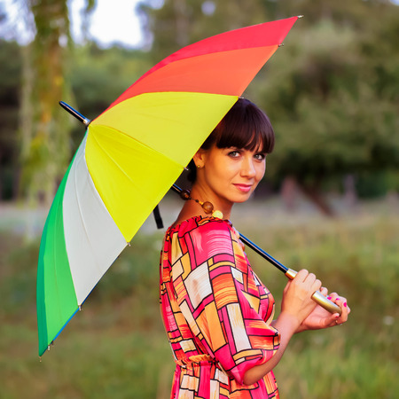 tree  forest: Beautiful woman in autumn park with colorful umbrella