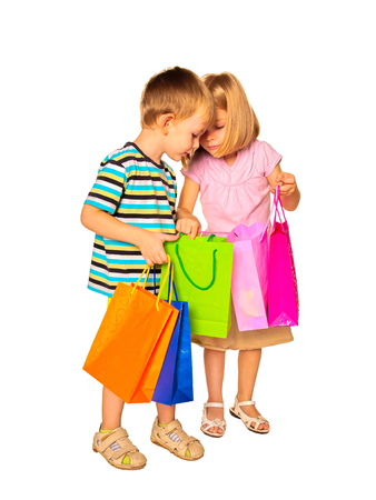 Happy kids with shopping bags. Isolated on white background. photo