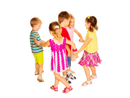Group of emotional children friends dancing. Isolated on white background photo