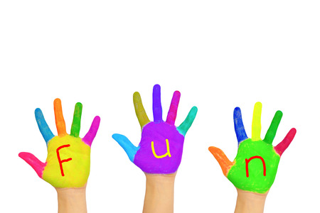 """The word """"fun"""" written on the multi-colored painted hands. Isolated on white background"""
