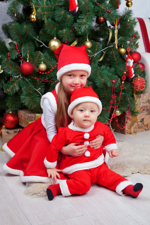 nursing sister: Brother and sister in Christmas clothes. Family look. Christmas and new year concept. Stock Photo