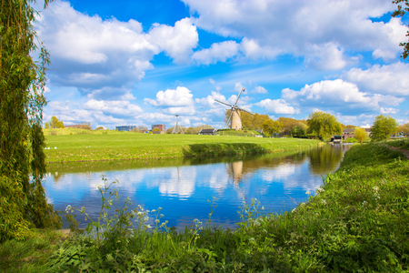 Windmill and channel. A typical Dutch landscape.