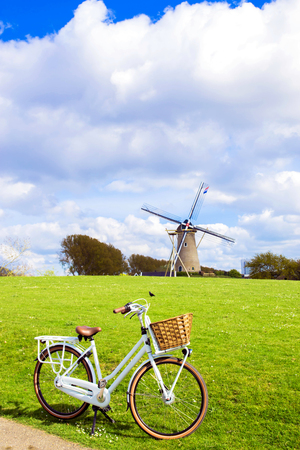 Bicycle and windmill. Symbols of the Netherlands. Tourism, bicycle tour, cycling, bicycling, bicycle travel concept.