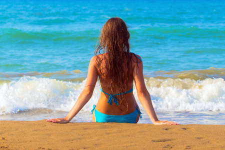 Relax on the beach. Woman enjoying sea and summer holidays.