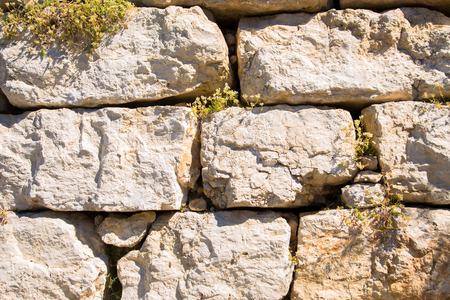 Old wall made of stone bricks. Background or texture. Stock Photo