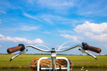Bicycle, field and blue sky with clouds. Travel, adventure, healthy lifestyle, environmental  friendly and vacation concept. Stock Photo