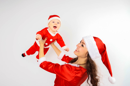 Santa Claus baby and Santa Claus mother play and laugh. Stock Photo