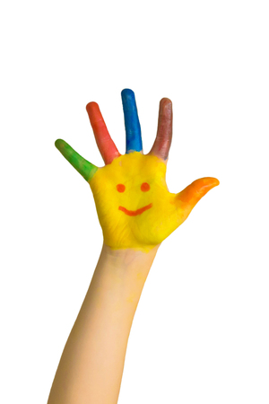 Children painted hand with smiling face. Happy kids draw smileys. Happiness, joy, education, creative, school concept. Creative, smart, funny child plays. Isolated on white background.