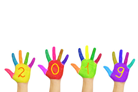 Kids colorful hands forming number 2019. Isolated on white background. Childrens joy and happiness. Family fun. The symbol of the new year. Party and holidays concept.