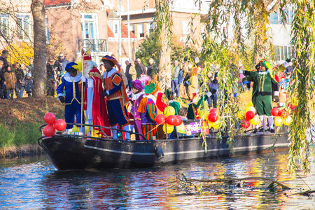 November 18, Hoofddorp, the Netherlands. The arrival of St. Nicholas Sinterklaas. Saint Nicholas arrives by boat with his assistants Black Pete.