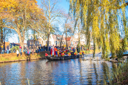 November 18, Hoofddorp, the Netherlands. The arrival of St. Nicholas Sinterklaas. Sinterklaas (Saint Nicholas) arrives by boat (stormboot) with his assistants Zwarte Pieten (Black Pete).