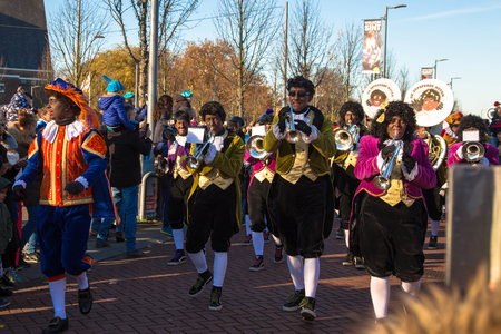 November 18, Hoofddorp, the Netherlands. The arrival of St. Nicholas Sinterklaas. Sinterklaas (Saint Nicholas) arrives with his assistants Zwarte Pieten (Black Pete). Sinterklaas rides his white horse along with his assistants. Everyone sings songs.