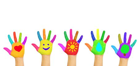 Colorful kid's hands with symbols of heart, smile, sun, water, tree painted on palms. Children, peace, happiness, joy, environmental protection,  volunteering, ecology concept. Isolated on white. Stock Photo