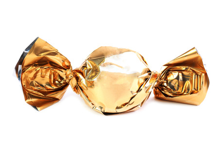 wrapper: Chocolate candy in golden wrapper  Stock Photo