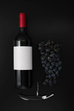 Bottle of red wine with label, corkscrew  and ripe grapes on black background