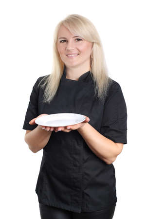 Woman chef in black uniform with empty plate isolated on white background Stock Photo