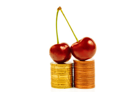 Sweet cherry on coins stack photo