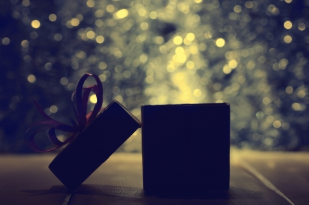 tonality: Gift box on abstract background in dark tonality