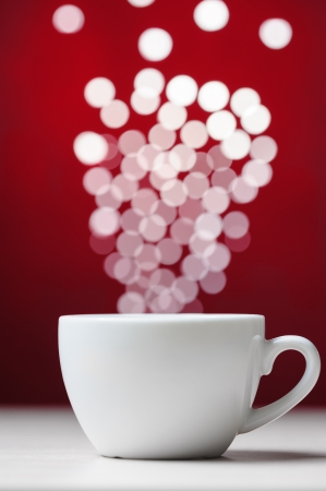 Defocused lights as aroma emanates from white coffee cup Banco de Imagens