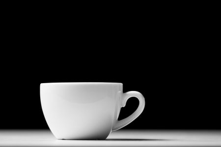 Defocused lights as aroma emanates from white cofee cup Banco de Imagens