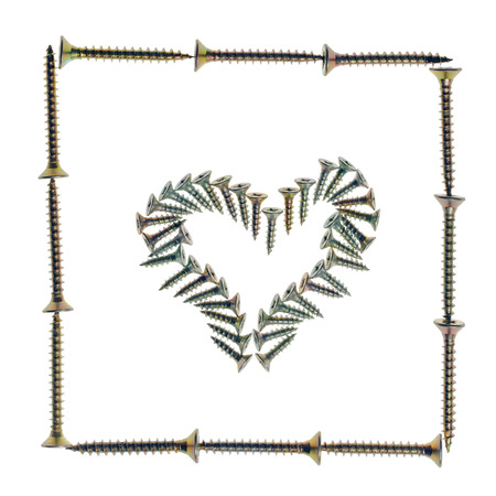 Heart symbol made of screws in frame, isolated on white