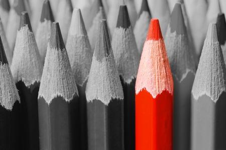 黒と白の間で赤鉛筆 写真素材