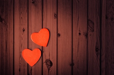 Valentines Day background, two hearts on wooden texture photo