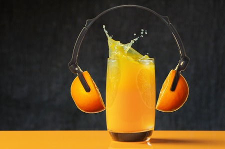 Loud sound, splash of orange juice 스톡 콘텐츠