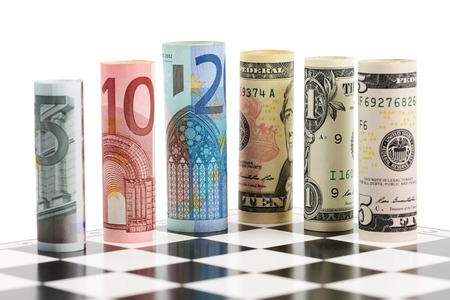 USD and Euro bank notes on chess board
