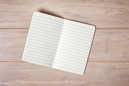 note book: Top view of open note book on wooden background