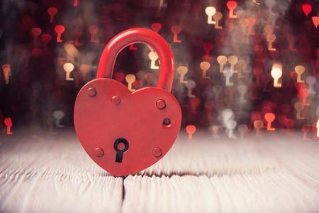 Heart shaped lock over defocused light shaped like keys Stock fotó