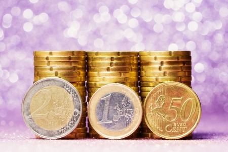 Euro coin stack over abstract background photo