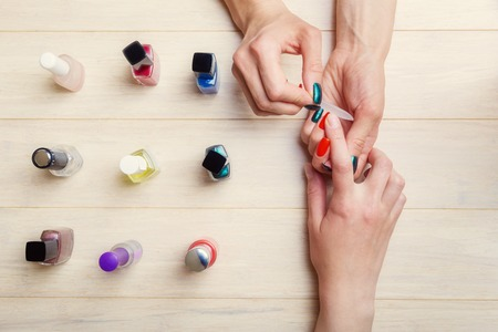 nail file: Manicure process at home, getting nails into shape