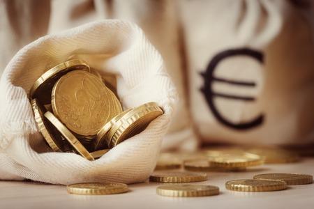 Euro coins in open money bag Stock fotó