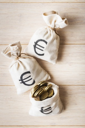 moneybag: Top view of money bags over wooden background Stock Photo