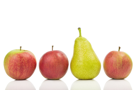 yellow  green: One pear in the middle of apples isolated on white